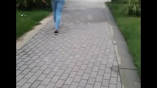 Petite mixed black Puerto Rican girl walking on campus