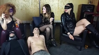 Three slaves are used as ashtrays by several ruthless mistresses