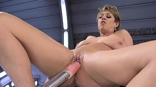 Busty Milf rides monster dildos coupled with machine