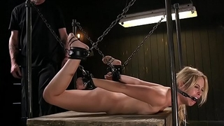Shackled and chained blonde tormented