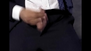 Chubby in suit, is jerking his little cock.