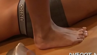 Dude enjoys his foot fetisj by lickng sexy babe'_s feet
